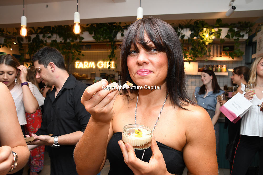 Jess of The Brockley Bean Box tasting a Sicilian Lemon Cheesecakes, served with Skinny Prosecco at Farm Girls Café, 1 Carnaby Street, Soho, London, UK on July 18 2018.