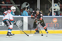 KELOWNA, CANADA, FEBRUARY 17: Alex Gogolev #10 of the Calgary Hitmen skates with the puck at the Kelowna Rockets on February 17, 2012 at Prospera Place in Kelowna, British Columbia, Canada (Photo by Marissa Baecker/Shoot the Breeze) *** Local Caption ***