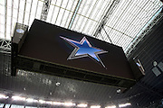 The Dallas Cowboys logo appears on the television screen high above the field during the NFL week 18 NFC Wild Card postseason football game against the Detroit Lions on Sunday, Jan. 4, 2015 in Arlington, Texas. The Cowboys won the game 24-20. ©Paul Anthony Spinelli