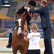 Lauren Barwick receives her medal from the Duke of Wessex after winning the grade II freestyle at the Hong Kong Venue of the 2008 Paralympic Games