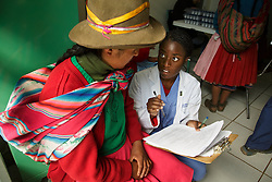 Medical College of Georgia student Afua Akhi-Gbade asks Francisca Huamani Huamani questions regarding her medical history at a small clinic on the outskirts of Cusco, Peru. Afua volunteered for CerviCusco, a nonprofit organization dedicated to reducing the spread of cervical cancer in Peruvian women. She was inspired to become a doctor after visiting her grandparents in Sierra Leone and seeing the need for quality healthcare.