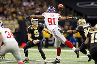 28 November 2011: Quarterback (9) Drew Brees of the New Orleans Saints passes the ball past (91) Justin Tuck of the New York Giants during the second half of the Saints 49-24 victory over the Giants at the Mercedes-Benz Superdome in New Orleans, LA.