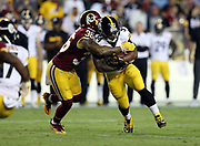Pittsburgh Steelers running back DeAngelo Williams (34) gets tackled by Washington Redskins defensive back Su'a Cravens (36) short of a first down with less than two minutes left in the second quarter during the 2016 NFL week 1 regular season football game against the Washington Redskins on Monday, Sept. 12, 2016 in Landover, Md. The Steelers won the game 38-16. (©Paul Anthony Spinelli)