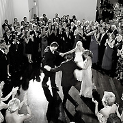 Black and White bird's eye view photo of large group doing Jewish Wedding Hora Dance at Tribeca Rooftop, NYC