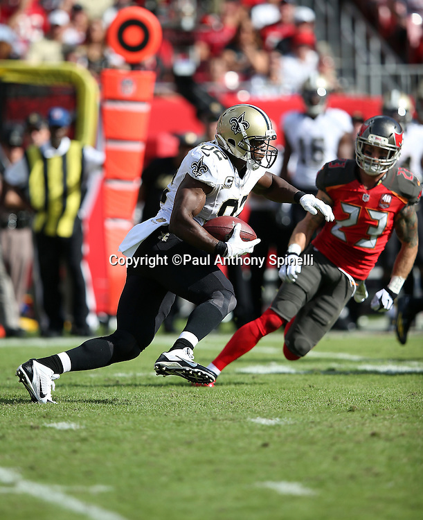 New Orleans Saints tight end Benjamin Watson (82) is chased by Tampa Bay Buccaneers strong safety Chris Conte (23) as he runs with the ball after catching a pass during the 2015 week 14 regular season NFL football game against the Tampa Bay Buccaneers on Sunday, Dec. 13, 2015 in Tampa, Fla. The Saints won the game 24-17. (©Paul Anthony Spinelli)
