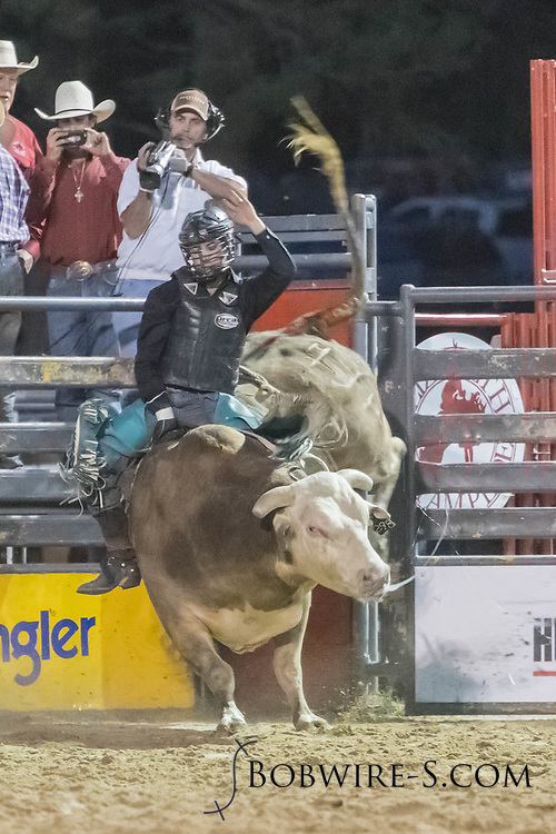 Bull rider Garrett Norby rides Summit Pro Rodeo's Game Changer in the second performance of the Elizabeth Stampede on Saturday, June 2, 2018.