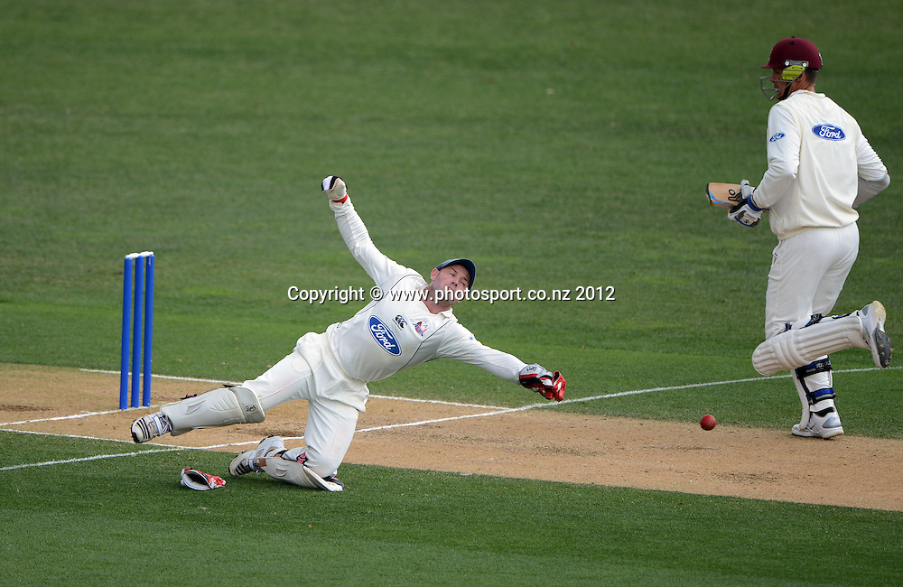 Gareth Hopkins dives in vain to stop a McClenaghan return. Plunket Shield Cricket, Auckland Aces v Northern Knights at Eden Park Outer Oval. Monday 12 November 2012. Photo: Andrew Cornaga/Photosport.co.nz