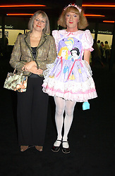 Right, Artist GRAYSON PERRY with his wife PHILLIPPA at a private view of the 2004 Frieze Art Fair - a major exhibition attended by most of the leading contempoary art dealers held in Regents Park, London on 14th October 2004.NON EXCLUSIVE - WORLD RIGHTS