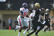 Ole Miss' Gerald Rivers (90) chases Vanderbilt quarterback Larry Smith (10) in Nashville, Tenn. on Saturday, September 17, 2011. Vanderbilt won 30-7..