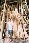 Owner Andew Dixon with bamboo building materials