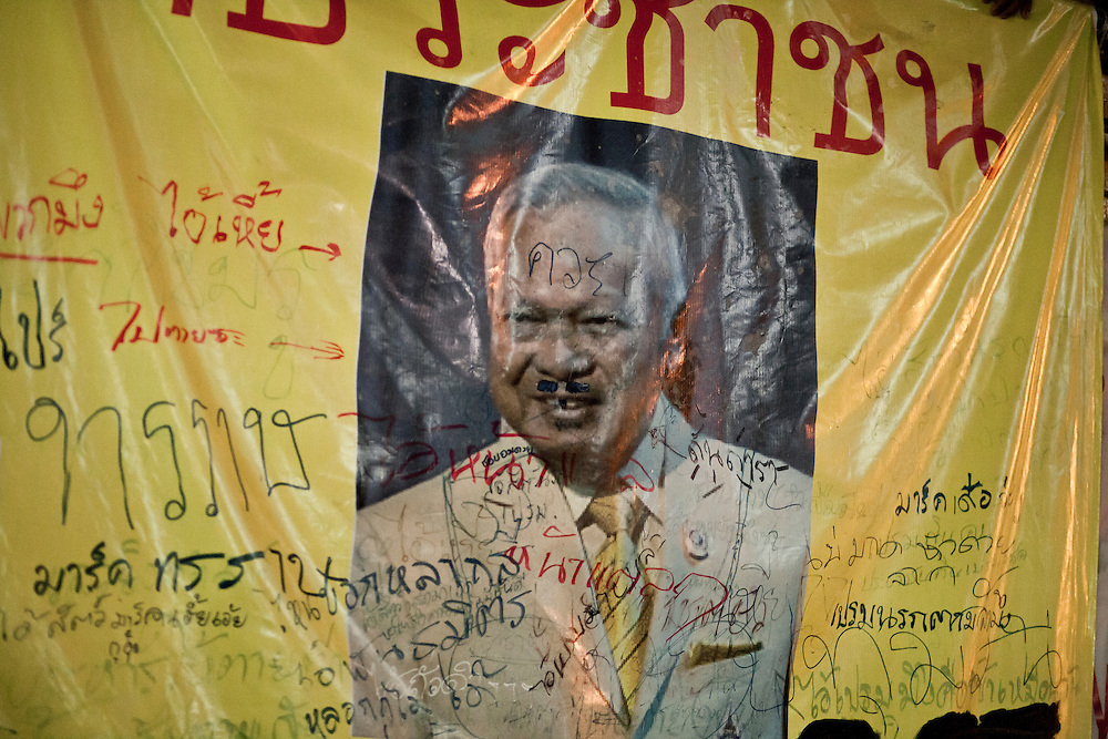 A portrait of the minister of security Suthep covered with graffits and insults in the barricaded camp of the Red Shirts at Ratchaprasong, in Bangkok, april 2010. He is the most hated figure of the government , the Reds ask for his trial after the massacre of the march 10, but the prime minster refused and launched the assault agiainst the camp on may 19 2010.