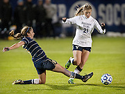 BYU forward Jaiden Thornock (21) evades Marquette's Ally Miller (3) during the NCAA Women's Soccer Sweet 16 match between BYU and Marquette University at BYU,Saturday, Nov. 17, 2012.