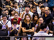 """16 JUNE 2017 - BANGKOK, THAILAND: People line up for the opening of a """"pop up"""" sale of cosmetics and perfumes in Amarin Plaza, an older mall in Bangkok's shopping district.          PHOTO BY JACK KURTZ"""