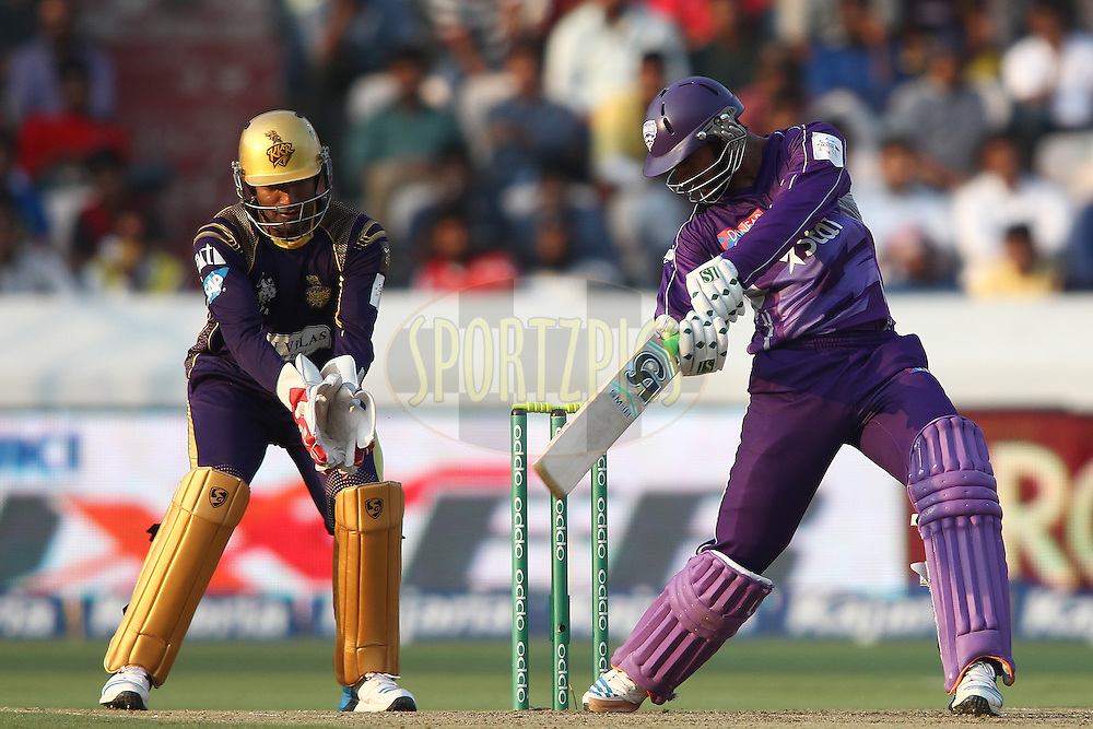 Shoaib Malik of the Hobart Hurricanes square cuts a delivery during the first semi final match of the Oppo Champions League Twenty20 between the Kolkata Knight Riders and the Hobart Hurricanes held at the Rajiv Gandhi Cricket Stadium, Hyderabad, India on the 2nd October 2014<br /> <br /> Photo by:  Shaun Roy / Sportzpics/ CLT20<br /> <br /> <br /> Image use is subject to the terms and conditions as laid out by the BCCI/ CLT20.  The terms and conditions can be downloaded here:<br /> <br /> http://sportzpics.photoshelter.com/gallery/CLT20-Image-Terms-and-Conditions-2014/G0000IfNJn535VPU/C0000QhhKadWcjYs