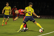 York City midfielder Josh Carson tangles with Oxford United defender, on loan from MK Dons, George Baldock  during the Sky Bet League 2 match between York City and Oxford United at Bootham Crescent, York, England on 29 September 2015. Photo by Simon Davies.