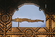 Traditional house. The wood's snake depicted on a traditional gate resembles a sort of animated banner<br /> used by the ancient Dacians in battle for scaring the enemy.
