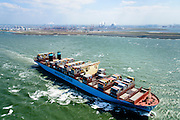 Nederland, Zuid-Holland, Rotterdam, 10-06-2015; <br /> Container schip Morten van rederij Maersk verlaat de haven van Rotterdam. In de achtergrond Tweede Maasvlakkte.<br /> Container Ship Morten Maersk leaves Port of Rotterdam.<br /> <br /> luchtfoto (toeslag op standard tarieven);<br /> aerial photo (additional fee required);<br /> copyright foto/photo Siebe Swart<br /> <br /> luchtfoto (toeslag op standard tarieven);<br /> aerial photo (additional fee required);<br /> copyright foto/photo Siebe Swart