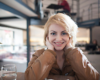 Portrait of beautiful young woman smiling in cafe