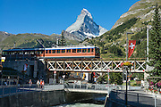 In Zermatt near the entrance to Sunnegga Express funicular, see the Matterhorn and Gornergrat Railway bridge over the Matter Vispa (a river tributary of the Rhone), in the Pennine Alps, Switzerland, Europe.