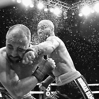 TAMPA, FL - JUNE 22: Artem Lobov catches Paulie Malignanni with a left hand during the Bare Knuckle Fighting Championships at Florida State Fairgrounds Entertainment Hall on June 22, 2019 in Tampa, Florida. (Photo by Alex Menendez/Getty Images) *** Local Caption *** Paulie Malignanni; Artem Lobov