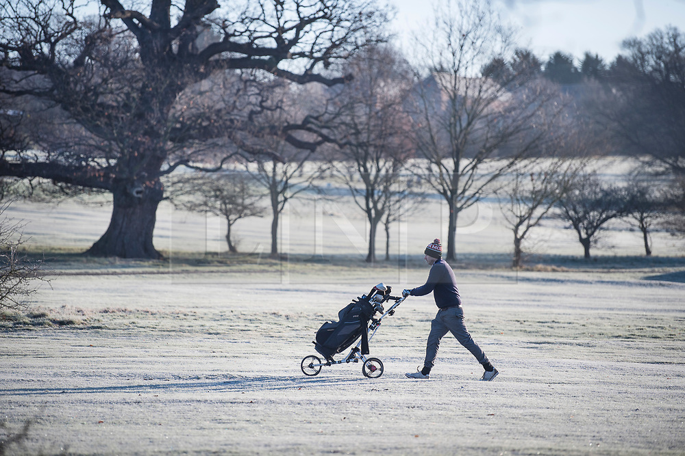 © Licensed to London News Pictures. 16/12/2017. London, UK. A golfer playing on a frost covered golf course in Richmond Park. Parts of the UK are experiencing freezing temperatures today with snow expected in parts. London, UK. Photo credit: Ben Cawthra/LNP