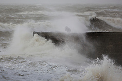 © Licensed to London News Pictures. 08/02/2016. Brighton, UK. A figure can be seen on the sea wall as storm Imogen hits the sea front at Brighton. Photo credit: Peter Macdiarmid/LNP