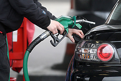 File photo dated 22/02/13 of a person using a petrol pump. Inflation is expected to have fallen in December to within a whisker of the Bank of England's target, due to lower motor fuel and tobacco prices.
