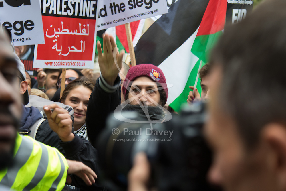 Whitehall, London, September 9th 2015.  A man appears to be making a Nazi salute, a gesture he repeated several times, as pro Palestinian and Israeli counter-protesters clash in Whitehall as the Palestinian Solidarity campaign demands the arrest of Israel's PM Benyamin Netanyahu for war crimes in the 2014 war with Palestinians in Gaza.  // Contact: paul@pauldaveycreative.co.uk Mobile 07966 016 296
