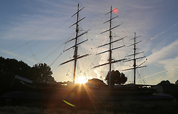© Licensed to London News Pictures. 06/10/2013. The morning sun rising above the Cutty Sark in Greenwich. Greenwich got off to a gloriously sunny day this morning with temperatures to hit 22 degrees today. Credit : Rob Powell/LNP