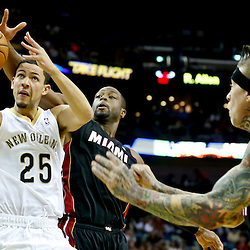Oct 23, 2013; New Orleans, LA, USA; New Orleans Pelicans shooting guard Austin Rivers (25) is defended by Miami Heat shooting guard Dwyane Wade (3) during the first half of a preseason game at New Orleans Arena. Mandatory Credit: Derick E. Hingle-USA TODAY Sports