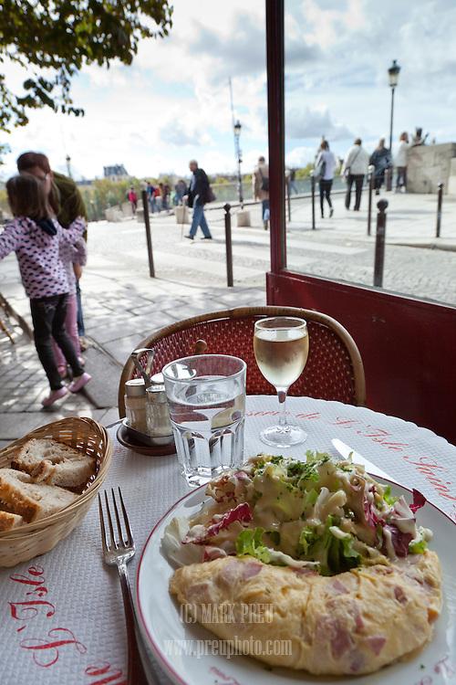 The photographer enjoying lunch at  Le Brasserie de Ile Saint Louis. The cafe is located on the  Quai de Bourbon on the Ile Saint Louis.