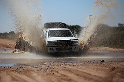NAMIBIA WATERBERG 3MAY14 - A 4x4 vehicle drives through a deep puddle on a gravel road inside the Waterberg Nature Reserve near Ojitwarongo, Namibia.<br /> <br /> jre/Photo by Jiri Rezac<br /> <br /> &copy; Jiri Rezac 2014