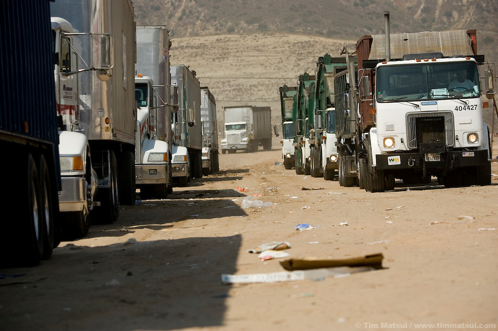 TUESDAY JULY 25, 2006 - LOS ANGELES, CALIF.  Garbage trucks line up to dump their loads at the Frank R. Bowerman Landfill near Los Angeles in Orange County, Calif. Seattle-based Prometheus is installing a facility to liquify the methane gas the landfill produces and currently flares into the atmosphere.