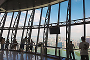 Macau, China - September 14, 2013: Unidentified people enjoy the view to the city from the TV tower observation desk in Macau, China.