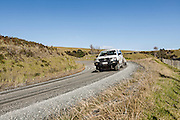 4 wheel drive going around unsealed bend in New Zealand