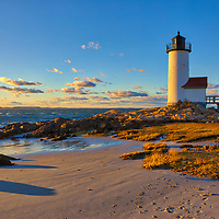 Annisquam Harbor Light in Gloucester, MA shortly is an iconic New England lighthouse located on Cape Ann, north of Boston. This lighthouse photo was captured shortly before sunrise when the last light of the day painted landscape and seascape in bursting colors.<br />