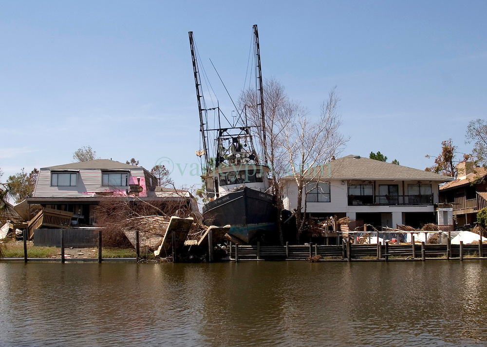 08 Sept 2005.  New Orleans, Louisiana. Hurricane Katrina aftermath. <br /> Venetian Isles in East New Orleans, where the tidal surge washed over the land and devastated homes and property. A shrimp boat rests between residential houses.<br /> Photo; &copy;Charlie Varley/varleypix.com