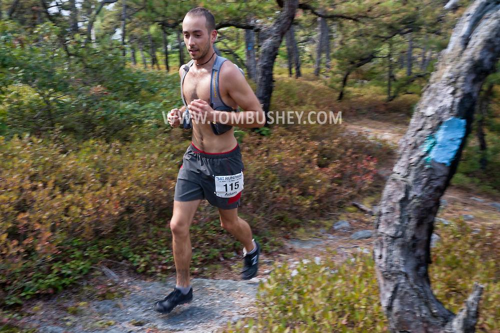 Kerhonkson, New York - Adam Meier runs along the trail at Minnewaska State Park Preserve during the Shawangunk Ridge Trail Run/Hike 32-mile race  on Sept. 20, 2014.