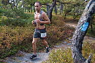 Kerhonkson, New York - Adam Meier runs along the trail at Minnewaska State Park Preserve during the Shawangunk Ridge Trail Run/Hike 32-mile race  on Sept. 20, 2014.