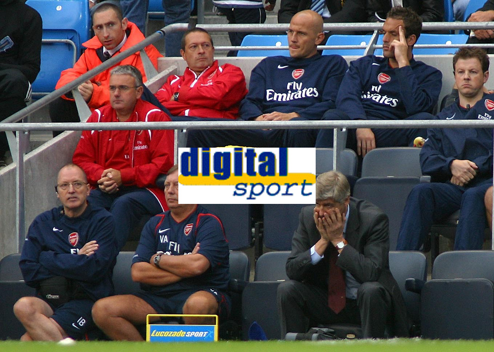Photo: Paul Thomas.<br /> Manchester City v Arsenal. The Barclays Premiership. 26/08/2006.<br /> <br /> Arsene Wenger, (Bottom R) Arsenal manager and the bench  look on not very happy.