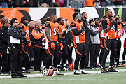The Cincinnati Bengals players and coaches stand at attention with hands across their chests during the playing of the National Anthem before the 2016 NFL week 13 regular season football game against the Philadelphia Eagles on Sunday, Dec. 4, 2016 in Cincinnati. The Bengals won the game 32-14. (©Paul Anthony Spinelli)