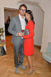 OLIVER TRESS founder of the Oliver Bonas stores and his wife GINA COLADANGELO at a party to celebrate the opening of the first Tabitha Webb Retail Store at 45 Elizabeth Street, London on 23rd September 2014.