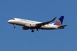 Embraer ERJ 170-200 LR (N131SY) operated by SkyWest Airlines for United Express on approach to San Francisco International Airport (KSFO), San Francisco, California, United States of America