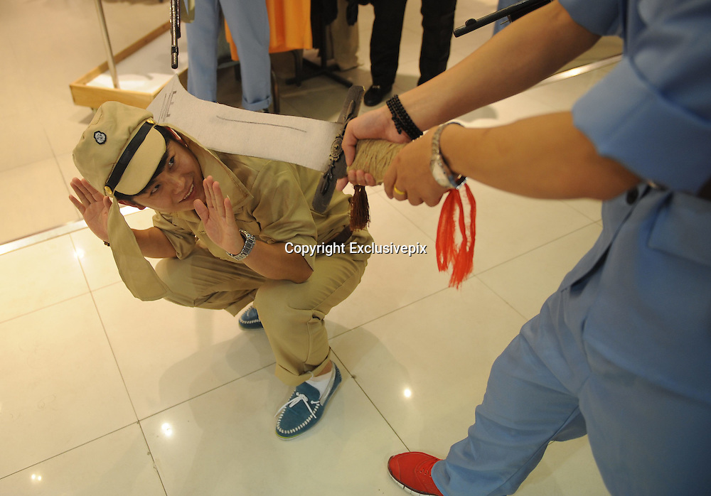 """TAIYUAN, CHINA - JULY 28: (CHINA OUT) <br /> <br /> Mall employees reenact WWII executions of Japanese soldiers to promote sales<br /> <br /> A shopping mall in Taiyuan, Shanxi Province sparked controversy and confusion when they had their workers don """"Eight Route Army"""" uniforms and reenact WWII executions of Japanese soldiers to promote sales. According to the manager, the mall started this """"anti-Japanese themed"""" promotion during the anniversary of the Japanese invasion of China on July 7th, to allow customers to reminisce/sell clothes. Because apparently not even sensitive chapters of history are off-limits when it comes to facilitating consumer spending. Not to mention that it makes about as much sense as Wal-Mart reenacting Omaha Beach in the furniture aisle to spur sales of bean bag chairs.<br /> This might be even worse than the time Harbin installed Japanese soldier urinals to """"promote pissing."""" <br /> ©Exclusivepix"""