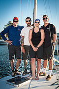 "Moore 24 sailboat #47 ""Moorality"" and summer season crew: (L to R) Andrew Haliburton, Josh Raymond, Stephanie Rice, JJ Miller, Columbia River, Portland, Oregon.  The Moore 24, designed by George Olson and Ron Moore, was one of the first ultralight displacement sailboats, or ULDBs.  Production 1972-1988."
