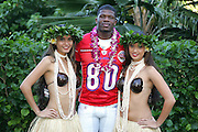KO OLINA - FEBRUARY 10:  Wide receiver Andre Johnson #80 of the Houston Texans and the 2005 NFL Pro Bowl All-Stars AFC Team poses with Hawaiian Hula girls for his 2005 NFL Pro Bowl team photo on February 10, 2005 in Ko Olina, Hawaii. ©Paul Anthony Spinelli