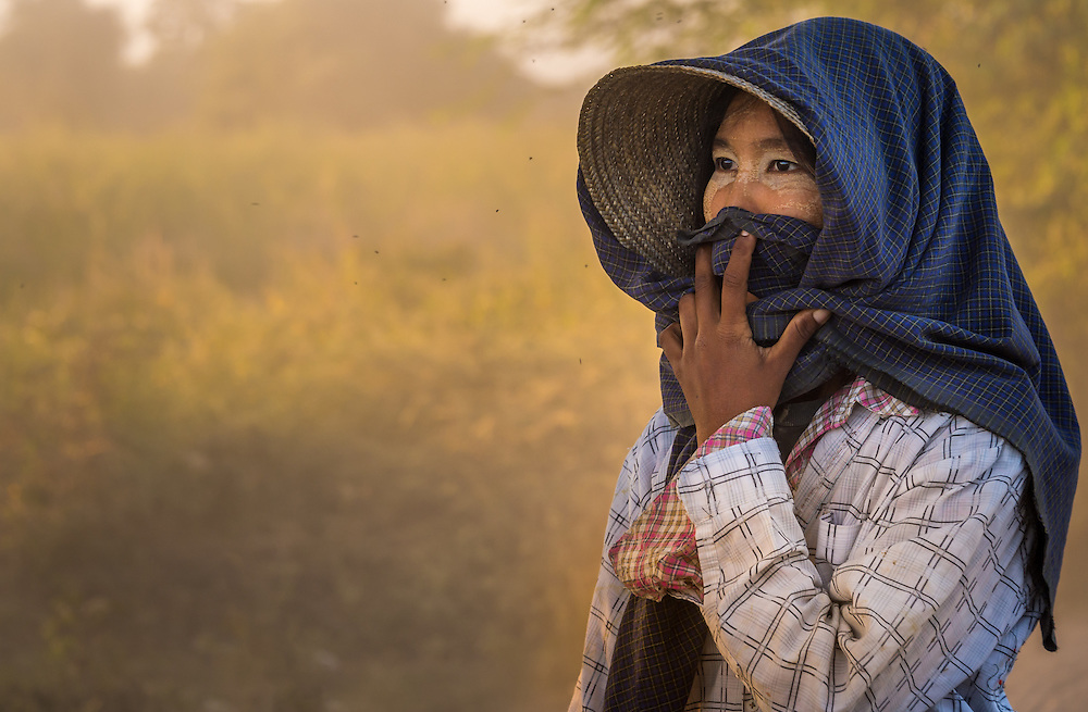 BAGAN, MYANMAR - CIRCA DECEMBER 2013: Portrait of burmese woman, a farmer from a village in the afternoon near Bagan in Myanmar