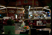 merry go round horse furniture inside a restaurant bar during night
