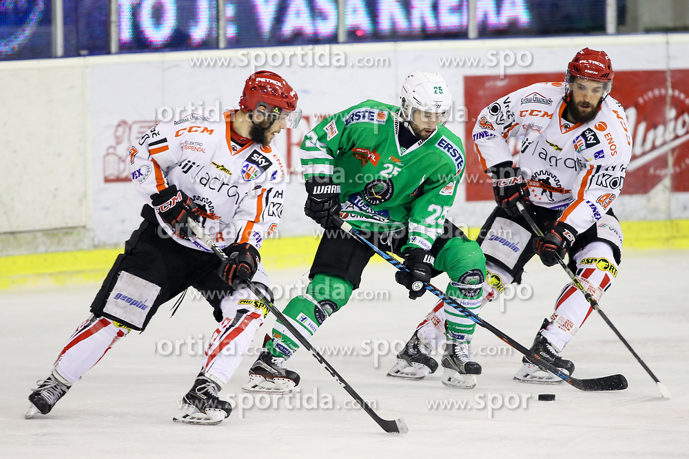 Crt Snoj of Olimpija and Martin Oraze of Jesenice during ice hockey match between HDD Olimpija Ljubljana and HDD SIJ Acroni Jesenice in Final of Slovenian League 2016/17, on April 12, 2017 in Hala Tivoli, Ljubljana, Slovenia. Photo by Matic Klansek Velej / Sportida