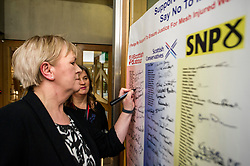 Pictured: Johann Lamont, MSP, signs the pledge watched by Claire Daisley<br /> Thousands of Scottish women have been fitted with polypropylene transvaginal mesh to treat pelvic organ prolapse or stress urinary incontinence. As a result women in every Scottish constituency have been severely injured or permanently disabled following this procedure, some have lost organs, many their careers and their relationships.&nbsp; The women and their families  are asking MSPs to sign a pledge <br /> <br /> Ger Harley | EEm 16 March 2017